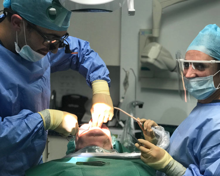 dentists and patient in surgery